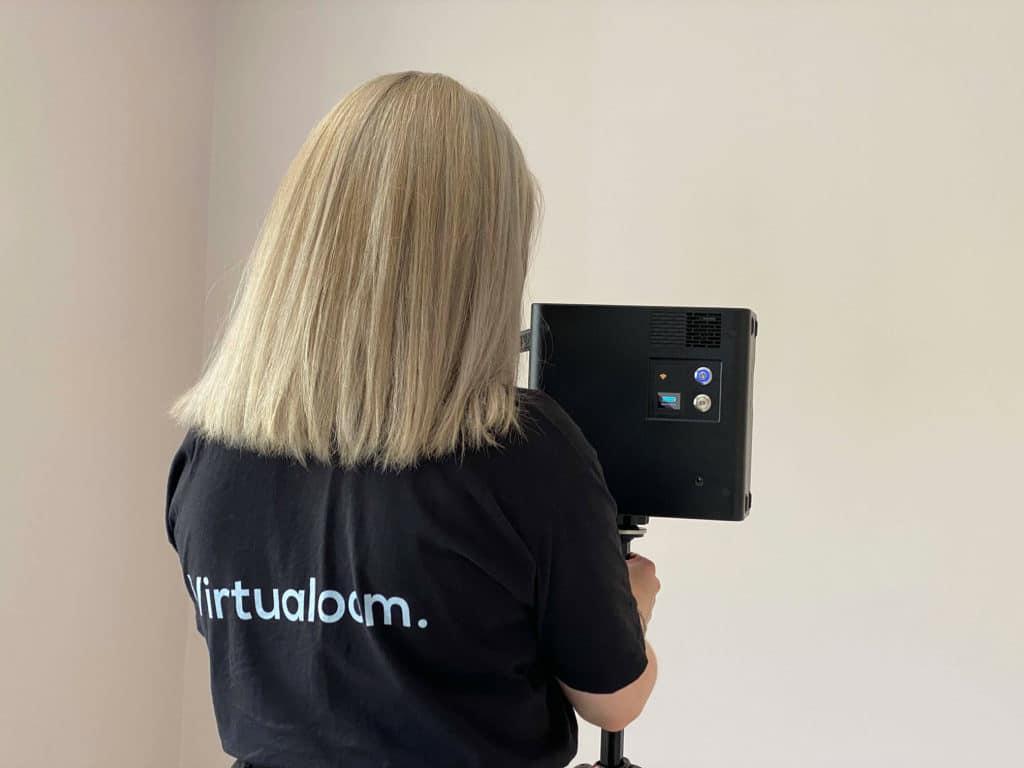 virtualoom founder olivia with matterport camera